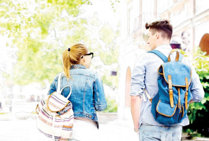 Pastel-style filter picture of male and female student walking