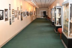 Civics art gallery with art pieces on the hall wall and in showcases