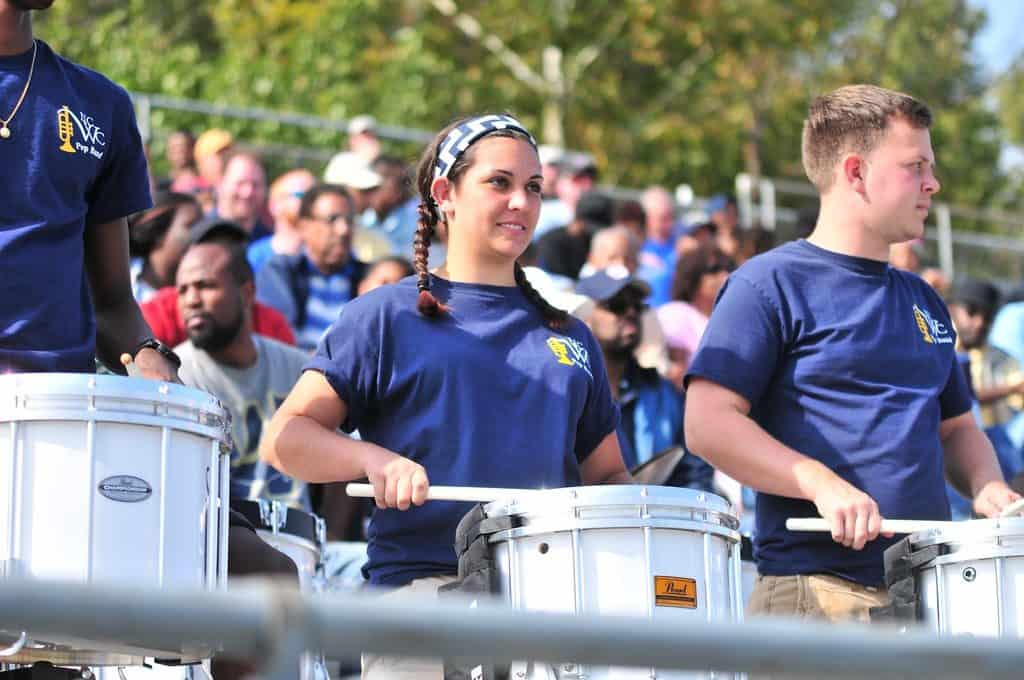 Band students with drums playing at a game