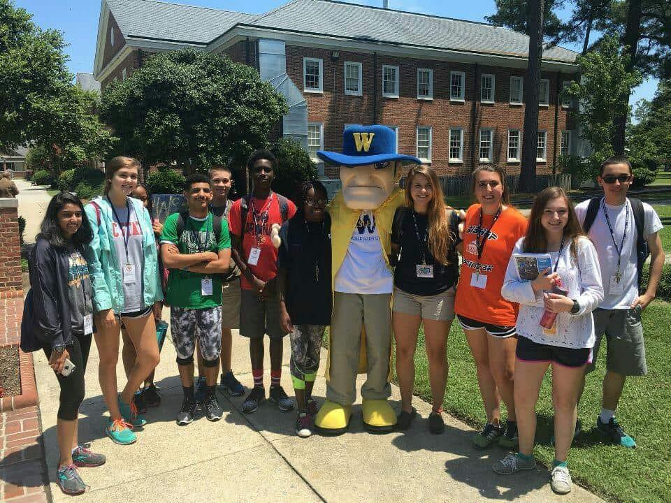 11 teens posing with Wes on NC Wesleyan's campus