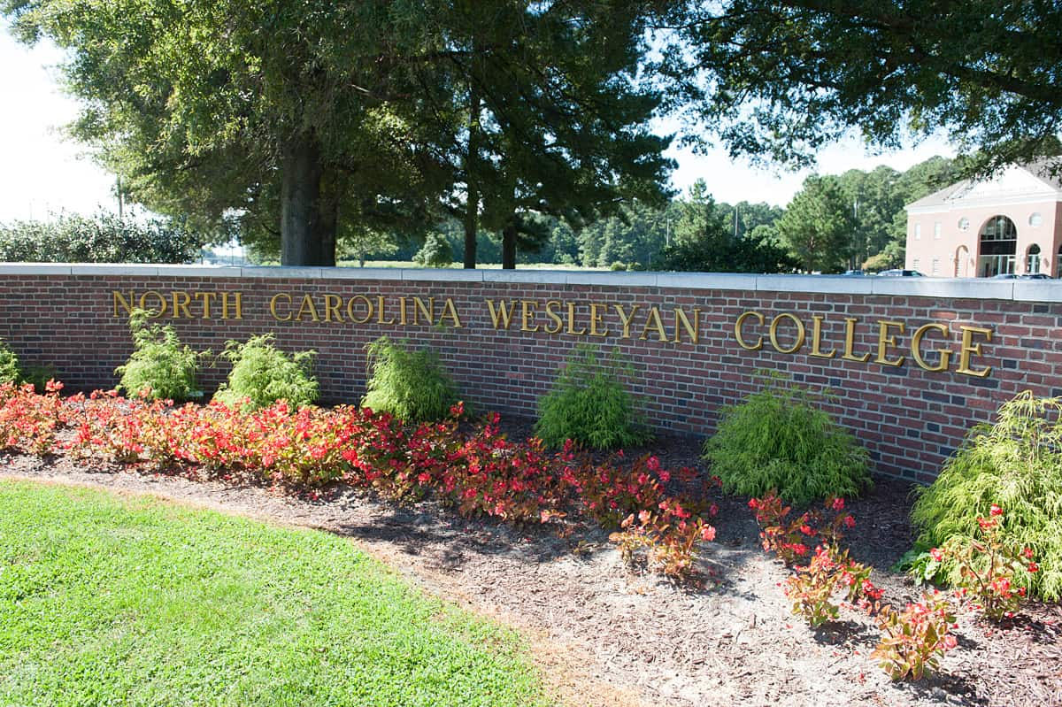 brick wall with North Carolina Wesleyan College spelled out