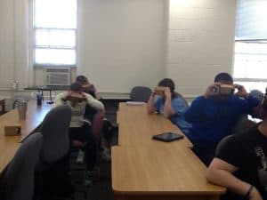 4 young adults trying Google Expeditions