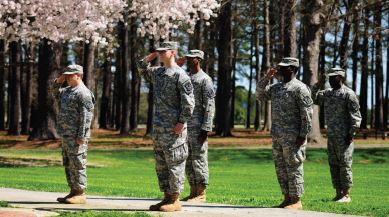 five ROTC cadets saluting