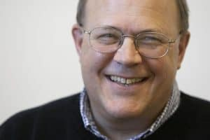 Close up of a smiling man in glasses