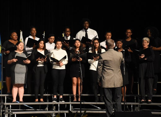 Choral group on stage performing on risers