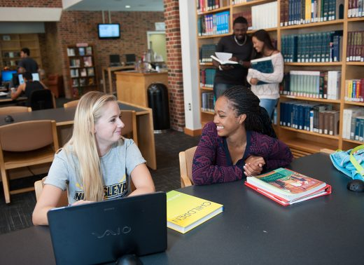 NC Wesleyan students in library
