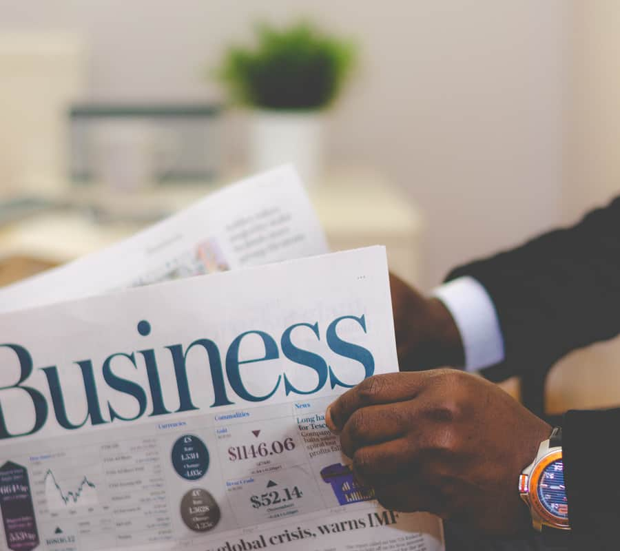 Closeup of hands holding a business newspaper