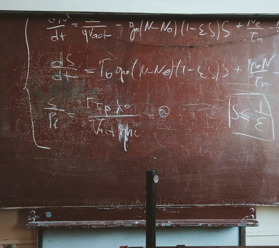 Picture of mathematical equation on an old chalk board