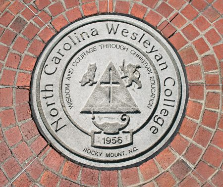 NCWC Seal surrounded by bricks