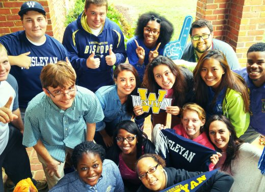 NC Wesleyan students with merchandise