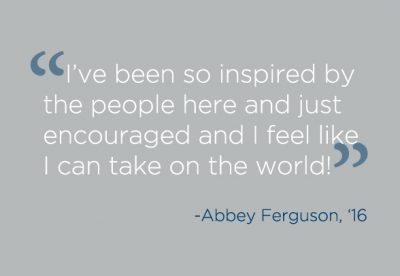"Grey backdrop with quote, "" 'I've been so inspired by the people here and just encouraged and I feel like I can take on the world!'-Abbey Furguson, 16."""