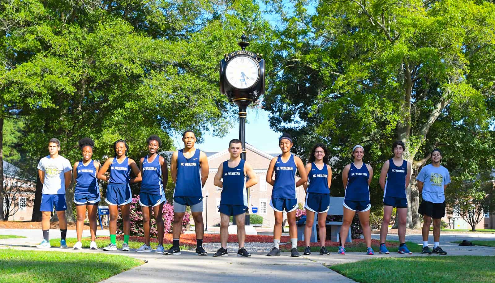 Team photo of the cross country team in royal blue uniforms