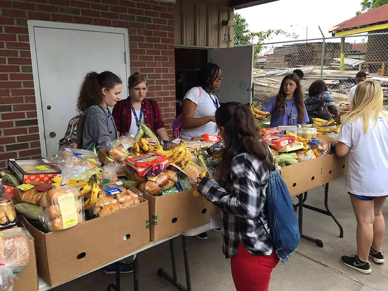 YTI students working with packaged food