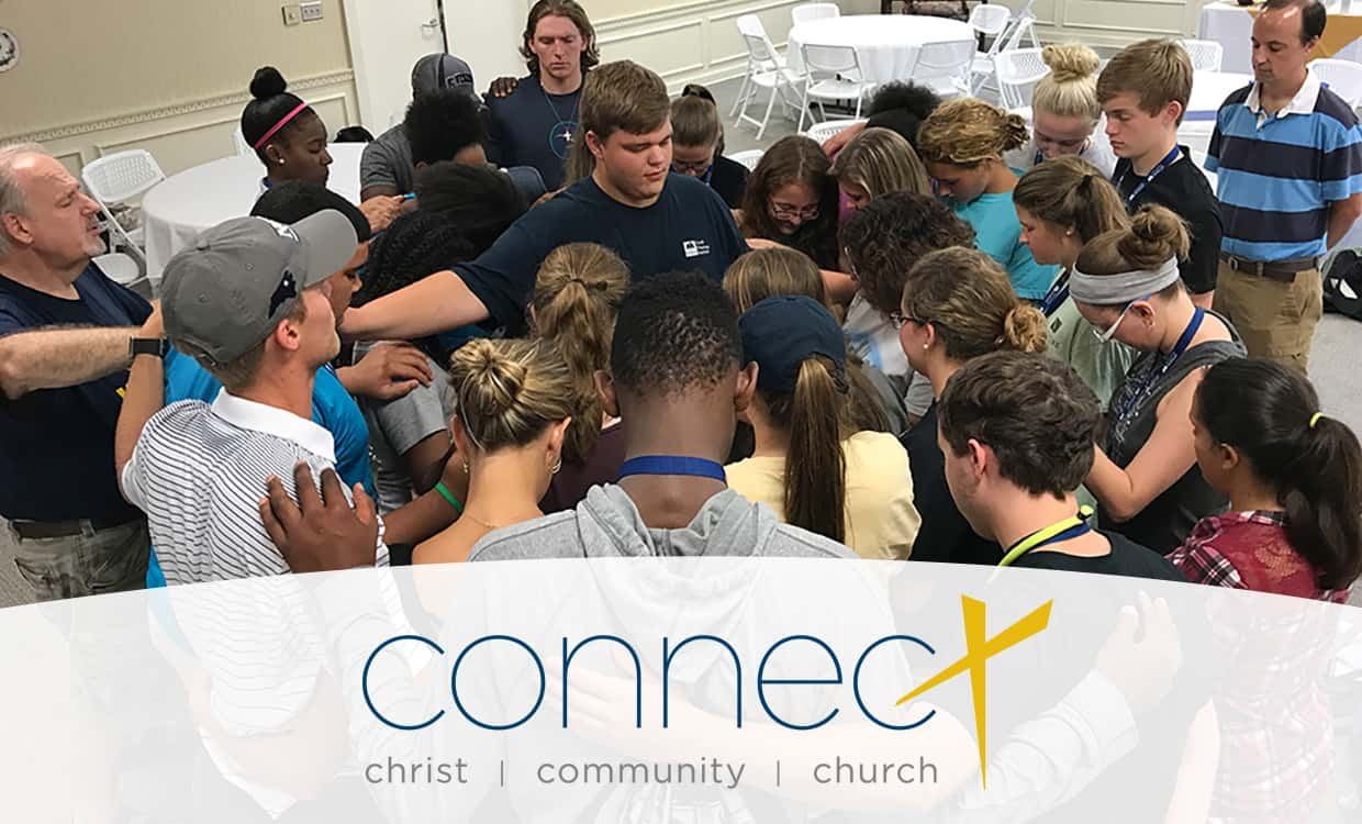 "Group of students and staff praying together with a Connect logo frame ""Christ, Community, Church."""