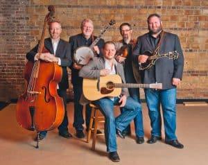 Five-man band of older gentlemen holding their instruments.