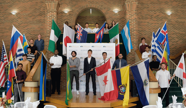 Group of international students holding their country's flags