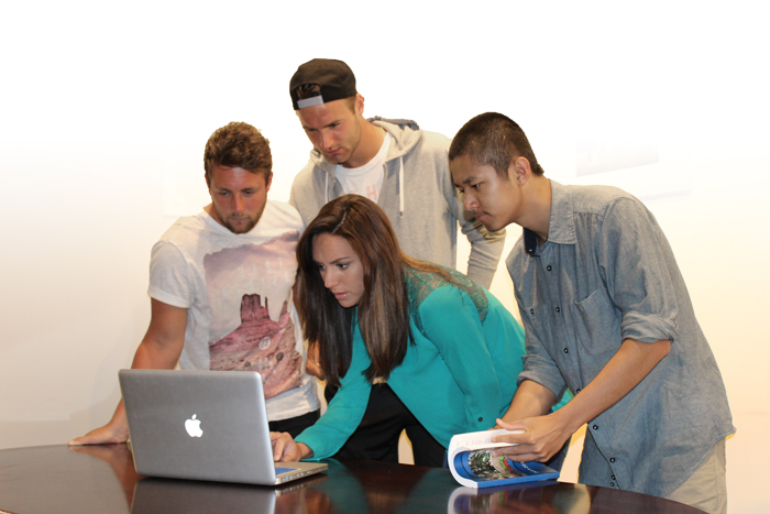 students looking at a laptop